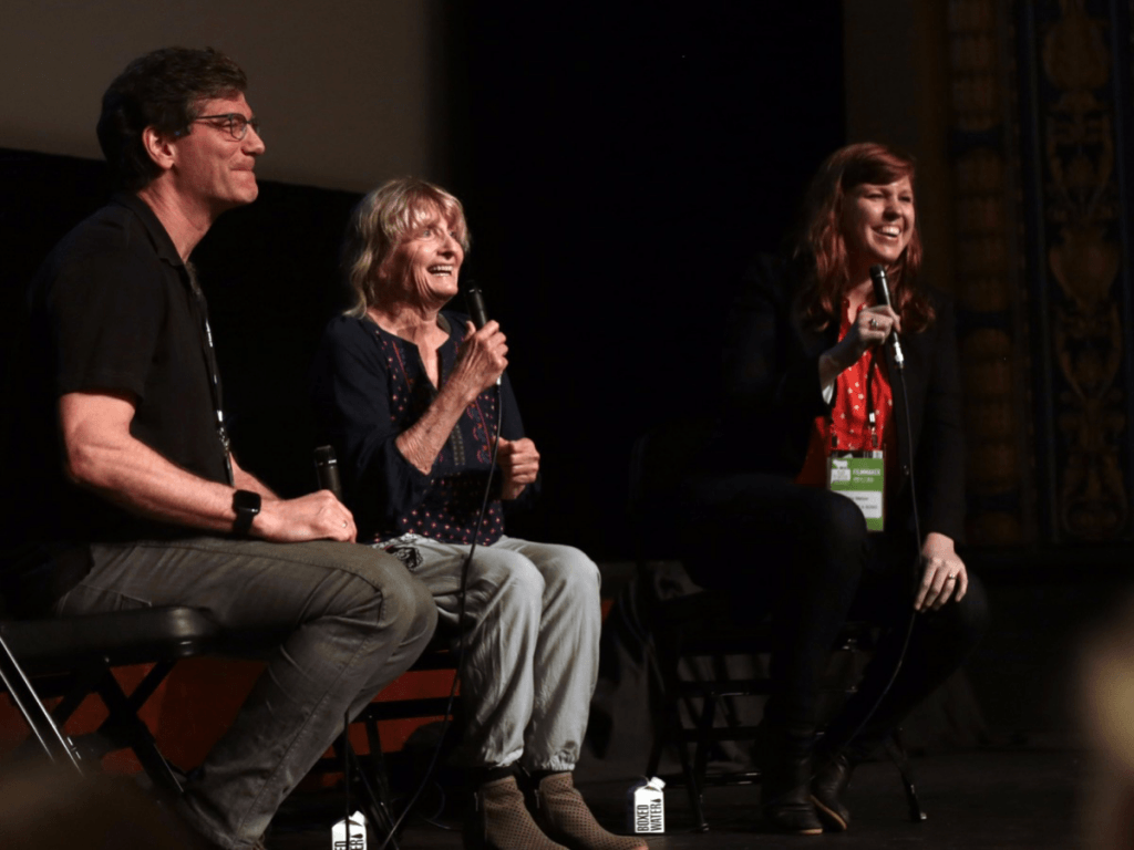 Kenny Dalsheimer (Director/Producer), Alice Gerrard, and Ashley Melzer (Producer) smiling and sharing in Q&A post screening
